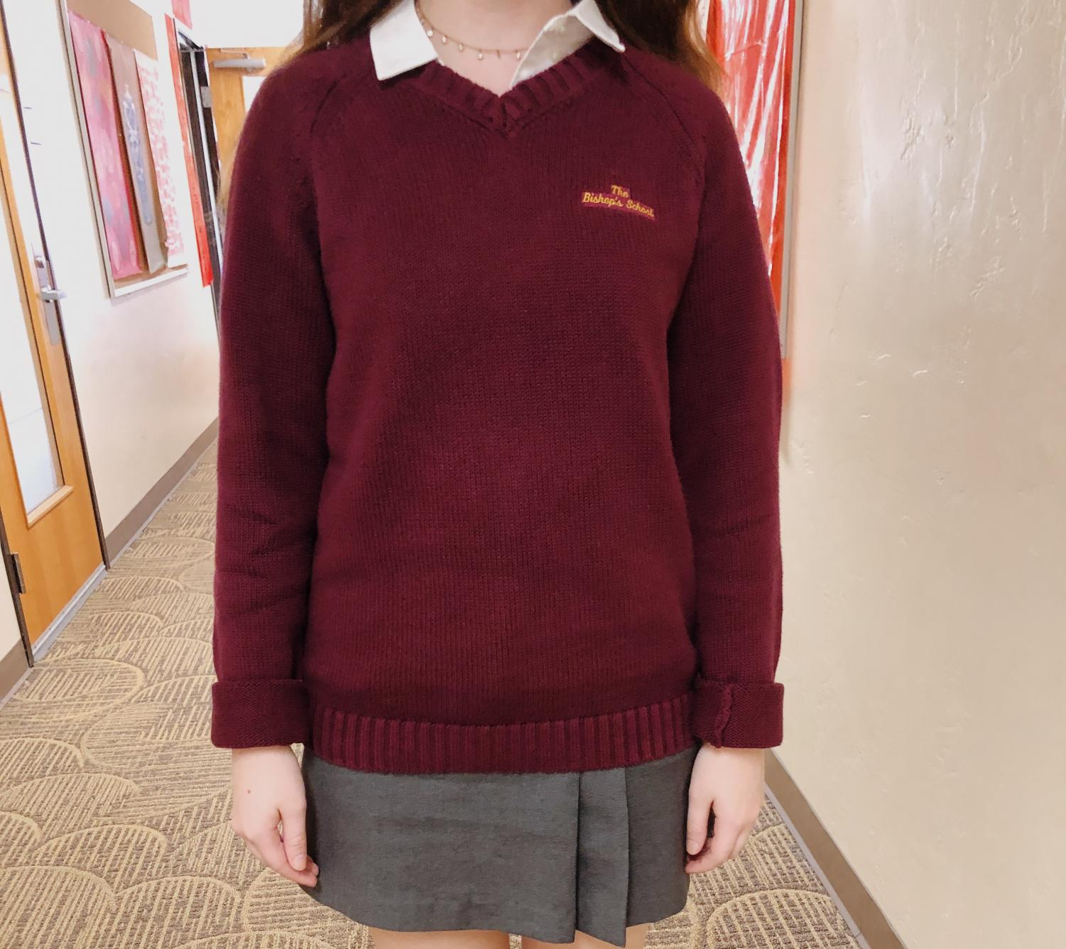 A student wears a maroon sweater on dress day.