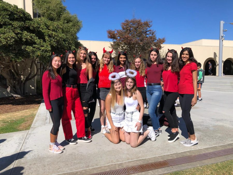 Pictured is the Varsity Girl's Tennis Team, with the seniors as angels and the rest of the team as devils.