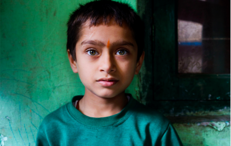 "One of Naomi's best portraits was featured in MoPa's ""Dreamscapes"" exhibit, showcasing a young Indian boy living in poverty. She admires the sense of hope in his innocent eyes that long for a ""better tomorrow."""