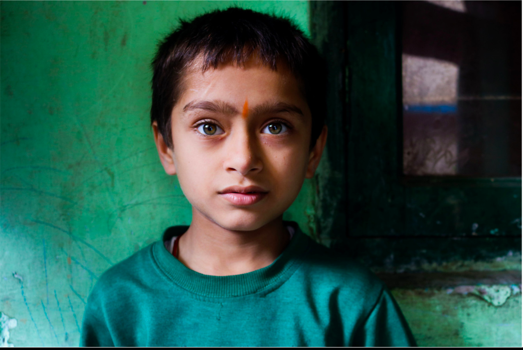 """One of Naomi's best portraits was featured in MoPa's """"Dreamscapes"""" exhibit, showcasing a young Indian boy living in poverty. She admires the sense of hope in his innocent eyes that long for a """"better tomorrow."""""""
