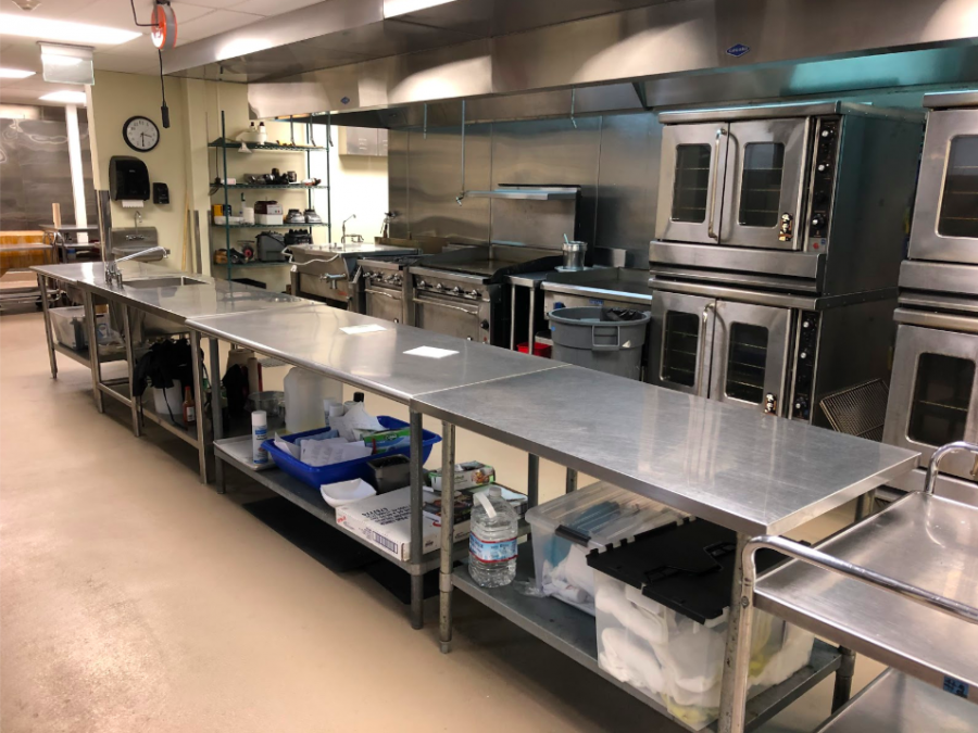 Two of the cafeteria's main rooms include multiple ovens, stoves, mixers, and tools.