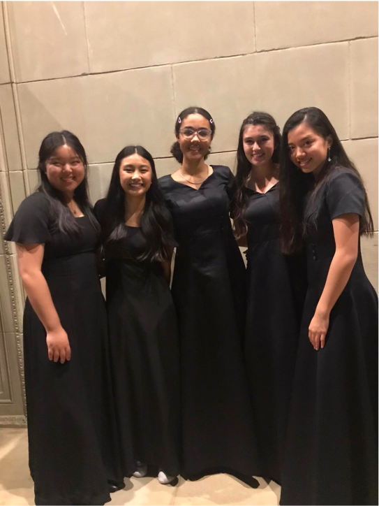 Pictured from middle to right: Maya Buckley ('22), Dolce Feenaghty ('22), and Haha Shi ('22), in their Bishop's Singers concert attire.