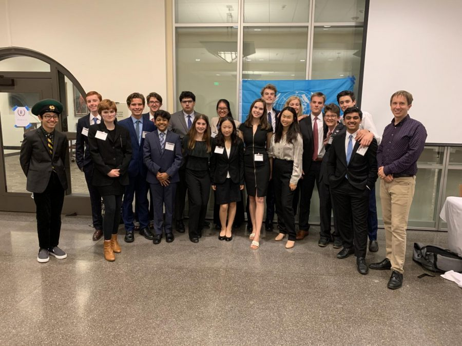 The Secretariat and other members of Model United Nations who put together Knights MUN find a moment to take a picture in the midst of a busy day.
