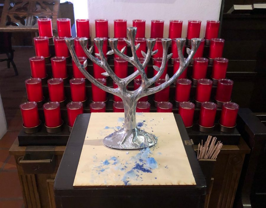 Hanukkah is celebrated with a nine-candled menorah, food, and games.