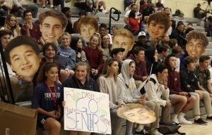 Bishop's fans and spectators sat in the stands, engrossed in the game. Many held posters celebrating the seniors, a common tradition during Senior Night games.  Photo courtesy of the Bishop's Athletics Instagram (@bishops_athletics)