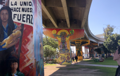 Murals are painted on the concrete support systems of the freeway that runs above Chicano National Park, adding color and character to the scene.