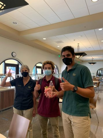 Ms. Sara Sweet and the kitchen staff have worked together to create a COVID-19 friendly food system.  Seniors Dylan Gruber and Krish Sheth show their approval during lunch on one of their on-campus days.